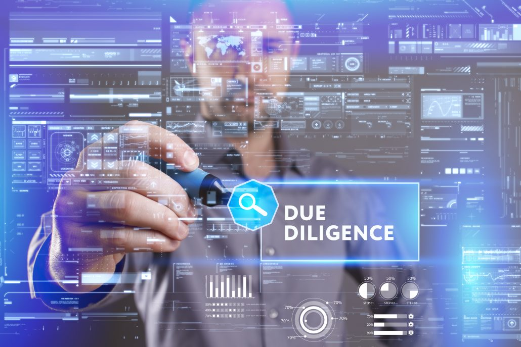 Business, Technology, Internet and network concept. Young businessman working on a virtual screen of the future and sees the inscription: Due diligence